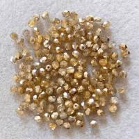 100 Glasschliffperlen 4 mm, kristall halbgold Bild 1
