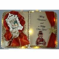 Festliches Weihnachts-Dekobuch mit Beleuchtung und Holz-Buchständer Bild 1