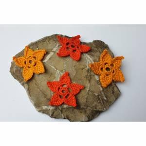 Häkelblumen, tunesisch gehäkelte orangene Häkelblüten