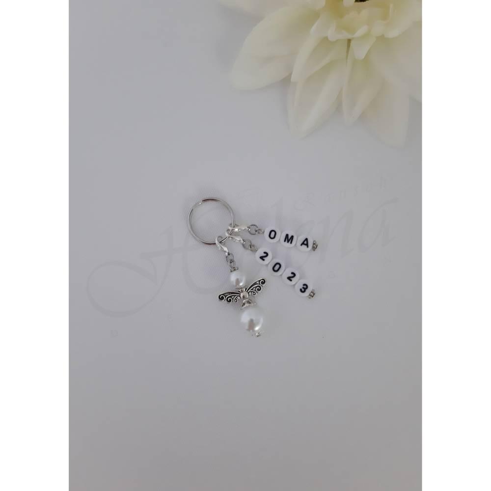 Personalisierter Schlüsselanhänger Schutzengel Perlen schwarz weiß Geburt Baby Schwangerschaft verkünden Geschenk Opa Oma Wort 2020 2021 Bild 1