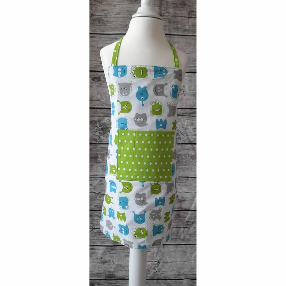 Kinderschürze / Kochschürze für Kinder etwa 3 - 5 Jahre, aus 100 % Baumwolle mit Tasche in weiß grün blau mit Monstern Bild 1