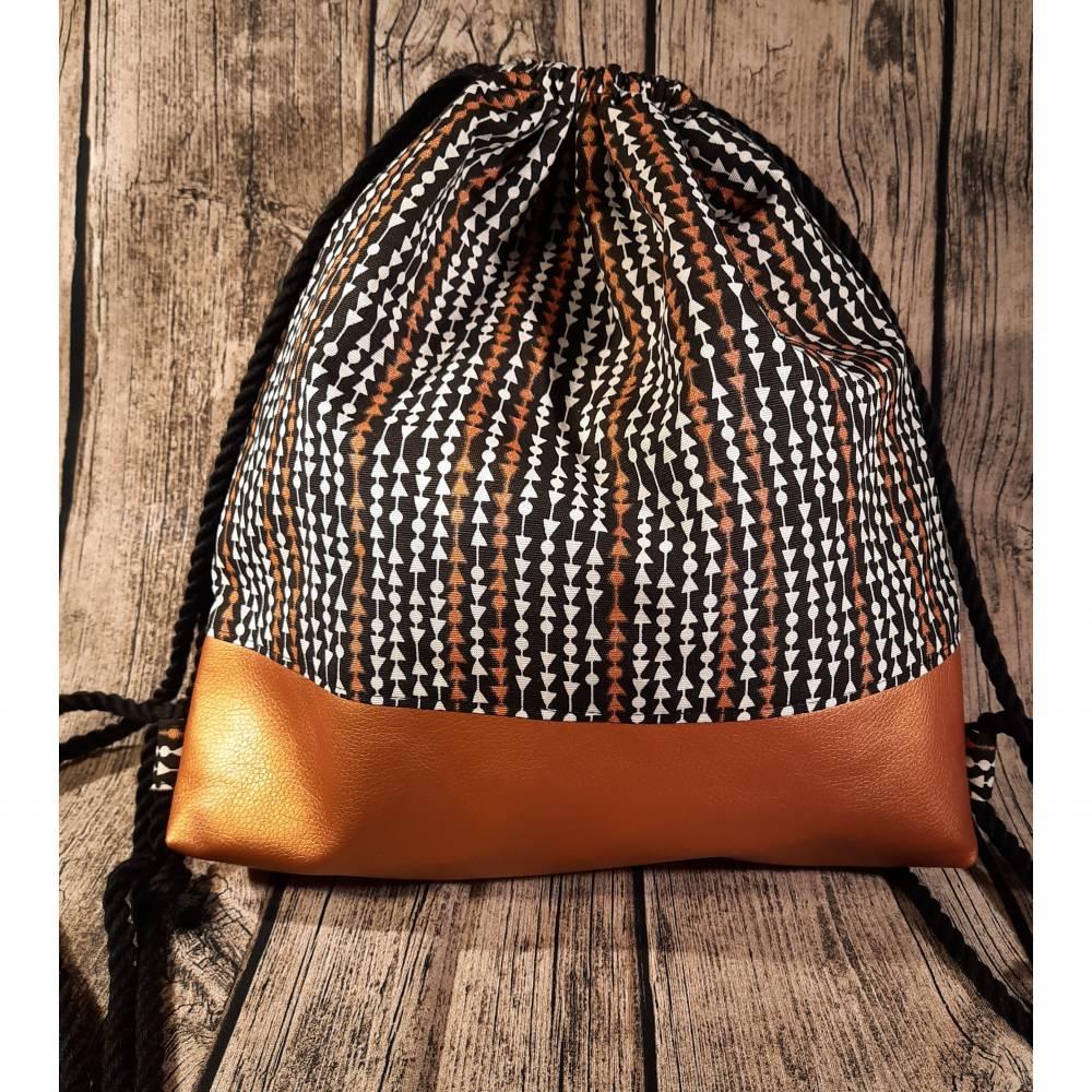 Turnbeutel Rucksack mit Kordeln aus Canvas und Kunstleder in schwarz / weiß / kupfer Bild 1