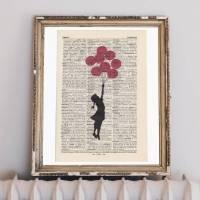 Banksy - Flying Girl - Druck auf antiquarischer Buchseite Bild 1