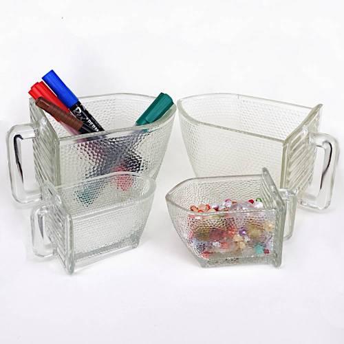 Alte Glasschütten verschiedener Hersteller in verschiedenen Größen