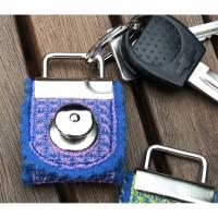 Zauberhaft bestickte Einkaufswagen-Chip-Täschchen als Schlüsselanhänger Bild 1