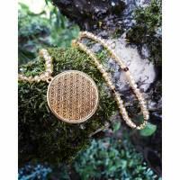 lange Glasfacettperlenkette mit Blume des Lebens - goldfarben Bild 1
