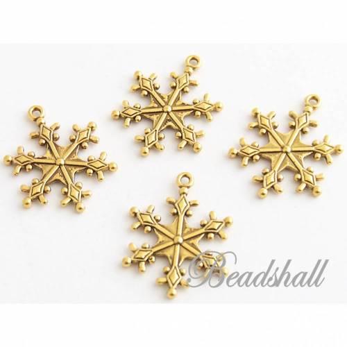 10 Sterne Charms goldfarben Schneeflocken Schmuckanhänger