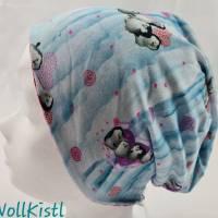 Mütze zum Wenden für 5-7 Jahre / Kopfumfang 50 cm, blau mit Pinguinen und pink gestreift mit Blumen und Schmetterlingen Bild 1