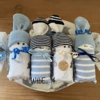 Windeltorte Junge: 4 Windelbabys im Tuch Bild 3