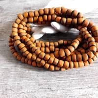 kleine handgemachte Glasperlen, Java - Orange auf Schwarz - ca. 6mm - ca. 110 Stück/Strang - indo-pazifische Perlen Bild 3