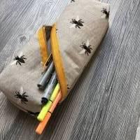 Täschchen mit schrägem Reißverschluss Bild 1