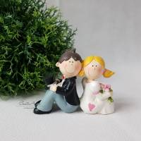 Hochzeitspaar Brautpaar sitzend Bild 1