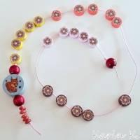 Rechenkette mit Holz- und Kunststoff- Perlen Gelb Orange Rehbraun Rosa Motivperle Glückwunschkarte und Geschenktasche Bild 10