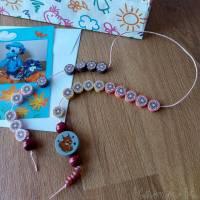 Rechenkette mit Holz- und Kunststoff- Perlen Gelb Orange Rehbraun Rosa Motivperle Glückwunschkarte und Geschenktasche Bild 4