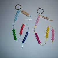 Einschulung, Rechenkette, Zählkette, 4x5 Holzkugeln mit Wunschnamen Bild 1